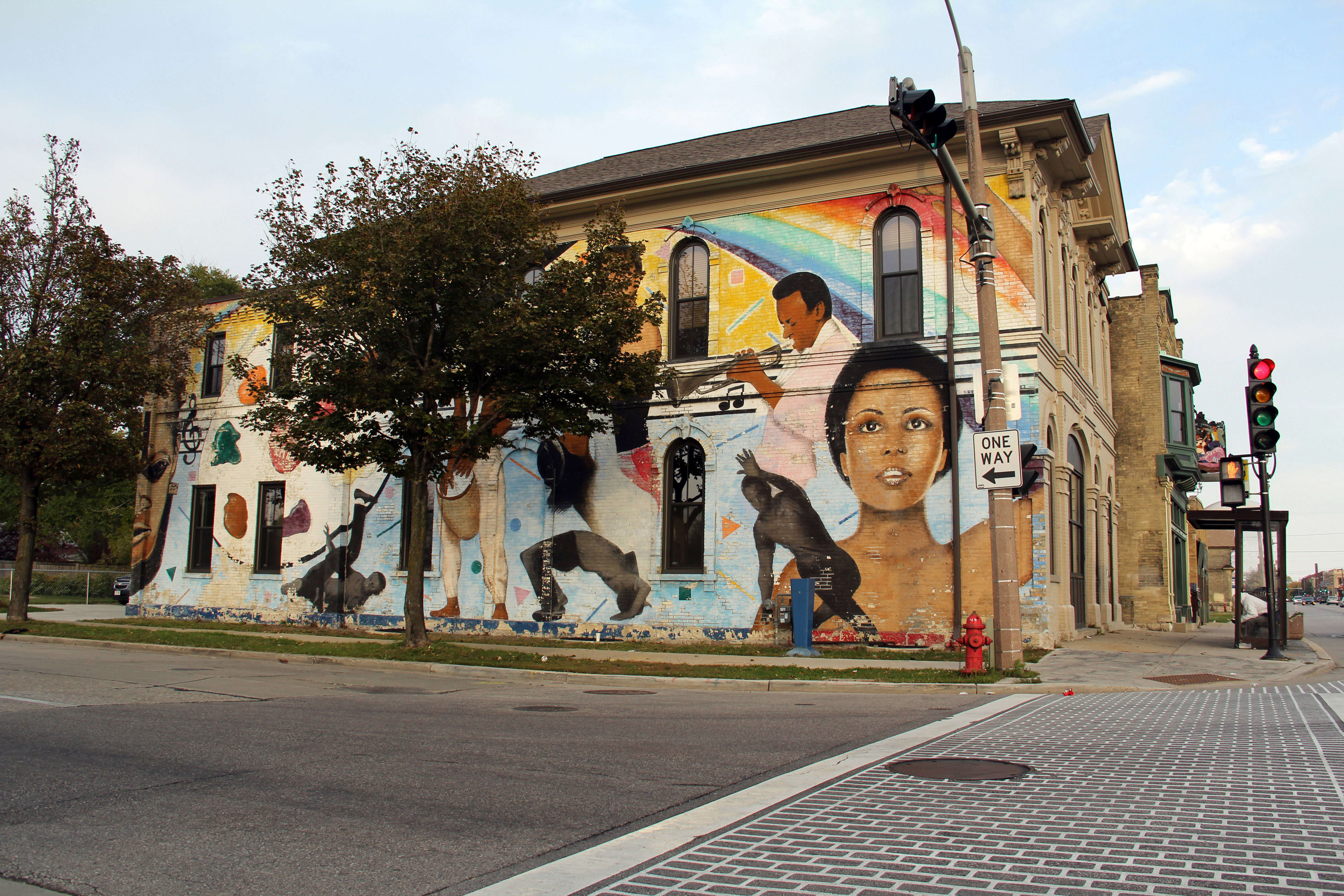 a painted mural celebrating diverse community art
