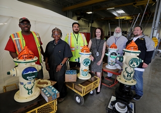 photo of utility staff with colorfully painted fire hydrants
