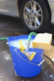 Do not leave a hose with the open end in a container, like a bucket of water for car washing.