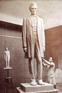 the statue's sculptor Gaetano Cecere posing with the completed work