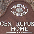 Detail image of a top section of Rufus King Home plaque.