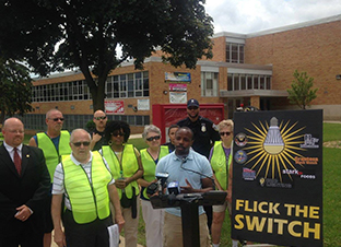 Image of Alderman Johnson talking about the new Flick the Switch program at a press conference.