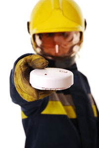 Firefighter with Smoke Alarm