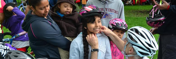 Children getting fitted for helmets.