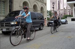 Cyclists commuting to work by Milwaukee's City Hall