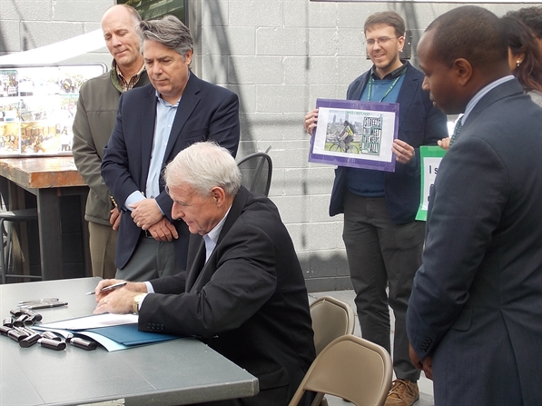 Mayor Barrett signing the Complete Streets policy into law