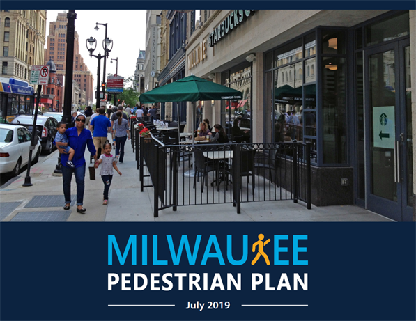 Cover photo from Milwaukee Pedestrian Plan adopted July 2019  showing family walking along Wisconsin Avenue in Downtown Milwaukee.