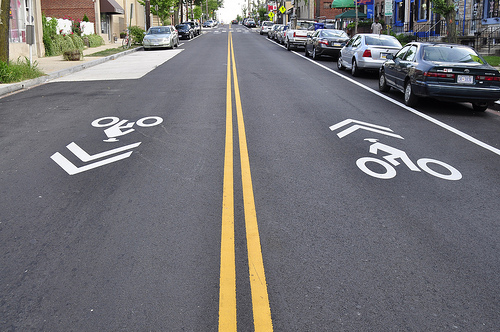 Examples of shared bike lane markings on both sides of a city street