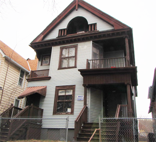 City owned home for sale 2910-12 West Galena Street - white and brown home duplex