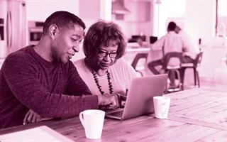 Seniors on laptop