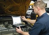 A photo of Andrew Suchy doing vehicle diagnostics