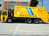 A photo of a Department of Public Works Garbage Truck