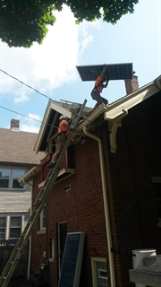 Photo of a residential rooftop solar instal