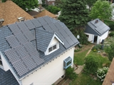 Aerial photo of residential rooftop home and garage solar paneling