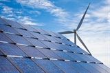 Photo of a solar array and wind turbine