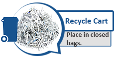 Photo of shredded paper and blue recycling cart