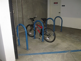 Bicycle locked up to a rack in a parking garage