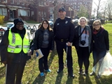 Photo of MPD officer and neighbors during a neighborhood cleanup event